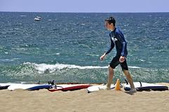A Boy Among Boards (AntyDiluvian) Tags: losangeles la california redondobeach beach southbay boy kid surfboards