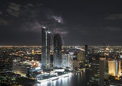 Stormy Sky (Camera_Shy.) Tags: storm sky skyline bangkok cityscape buildings lightening city night long exposure lights nightime landscape urban view tropical weather skyscrapers thailand