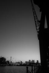 Under the crane (Janne Räkköläinen) Tags: london lontoo uk unitedkingdom docklands crane cityview citylife citylights cityriver thames street streetphotographing streetview underthecrane fujifilm fujifilmx70 x70 enjoying blackwhite bnw sky amateur amateurphotography photo photographing 2017 bw buildings center