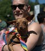 Cute Dog Gets Carried (Scott 97006) Tags: man dog canine animal guy carry cute parade colors