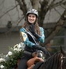 Ride Smile Wave (Scott 97006) Tags: woman female lady equestrian rider waving smiling horse parade flowers