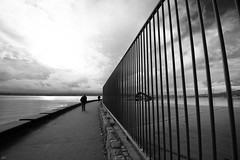 halfway (bluechameleon) Tags: sharonwish westend blackandwhite bluechameleonphotography clouds curves fence lines monochrome people pool reflections seawall secondbeach sky textures vancouver