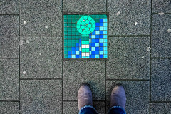 I couldn't hear it (Melissa Maples) Tags: brussel bruxelles brussels belgique belgië belgium europe apple iphone iphone6 cameraphone winter grey pavement art mosaic tile me melissa maples selfportrait woman shoes jeans boots feet