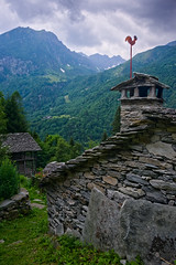 ... and then it comes the storm. (Marco MCMLXXVI) Tags: alagna valsesia piemonte italy alps alpi montagna mountains storm rainstorm rain temporale summer estate hiking escursionismo outdoor nature building stone peak tower weather landscape scenery sony ilce6000 a6000 pz1650 rawtherapee mood mountainside forest green valley canyon