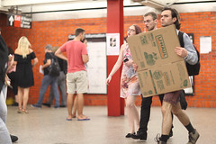 People in the 49th Street subway station getting off the N train.  That guy who's blocked by cardboard was wearing a tuxedo. (kevinrubin) Tags: newyorkcity street streetphotography nyc newyork unitedstates us