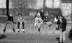 Enjoying the evening sun 01 (byronv2) Tags: edinburgh edimbourg scotland blackandwhite blackwhite bw monochrome peoplewatching candid street sunny sunshine sunlight spring sitting seated saintgilescathedral cathedral church kirk parliamentsquare oldtown royalmile