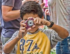 Off kilter kid cameraman (Pejasar) Tags: escuelaintegrada guatemala antigua boy photographer child photographyclass youth offkilter crooked shot coolpix nikon weeklythemes