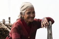 0775 Nepali Woman (Hrvoje Simich - gaZZda) Tags: outdoors people woman portrait old red nepal asia travel nikon nikond750 nikkor283003556 gazzda hrvojesimich