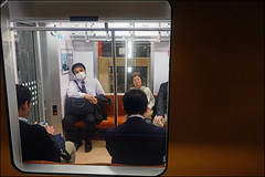 Really...?! - Tokyo, Japan (TravelsWithDan) Tags: man mask people subway metro throughtheglass candid angry streetphotography tokyo japan canong3x ngc