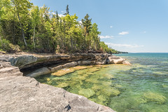 Christmas in June (Aaron Springer) Tags: michigan upperpeninsulaofmichigan lakesuperior thegreatlakes lakeshore water stone rock trees sunny christmas paradisepoint outdoor nature landscape