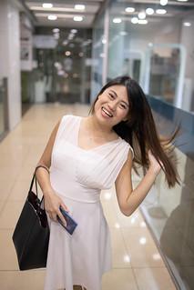 Happy Singaporean woman walking in shopping mall