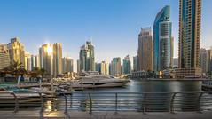 The city from the sand (\Nicolas/) Tags: emirates arab united dubai dubaï boat ship yatch marina skyscrapper tower golden