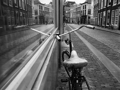 Reflected (weerwolfje) Tags: bicycle relfection reflected olympus omd dordrecht window bnw bw blackandwhite street streetphotography