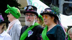 Processions Edinburgh 2018 028 (byronv2) Tags: processions processionsedinburgh edinburgh edimbourg meadows middlemeadowwalk scotland woman women candid street peoplewatching protest march rally suffragette votesforwomen 1918 2018 feminism politics vote voting portrait green tophat hat goggle steampunk man beard