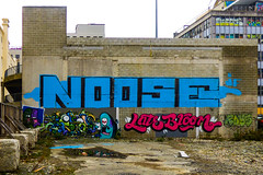 Noose (Steve Taylor (Photography)) Tags: graffiti mural streetart tag fence blue green yellow mauve purple red concrete newzealand nz southisland canterbury christchurch cbd city gravel alien dtr ikarus latebloom monster yikes noose jf roys