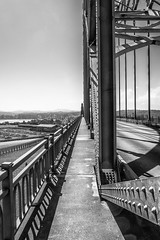 Steel & Concrete to the Horizon (TCeMedia/Telecide) Tags: bridge steel concrete cement newport oregon sky blackandwhite metal rivets vanishingpoint