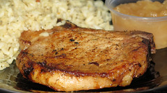 Pork Chop with Rice & Apple Sauce (Coyoty) Tags: cornercafe tunxiscommunitycollege farmington connecticut ct college cafe food pork chop porkchop meat rice apple sauce applesauce brown white black bokeh fruit grilled