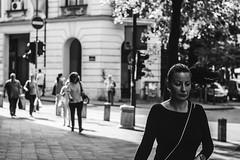 Walking (Santiago Koroviev) Tags: street streetphotography streets bwstreet blackandwhitestreet blackandwhitestreetphotography blackandwhite blackandwhitephotography belgrade bnw bnwmood beograd bnwportrait bw blackandwhiteportrait blackandwhiteworld wondering world people expression emotion lenses retro grainy grain touching city outdoors contrast contrasty photography vintage portraitnoir portrait dust jupiter jupiter37a blues manual manualfocuslenses focus solitude lightsandshadows lights highcontrast films film filmnoir moody moods noir mood noiretblanc noire color loneliness movies spring depression darkness dark shadows shadow dreamer serbia melancholy hardday peopleonthesteet woman walking daytime