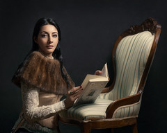 Days of future passed II (Giulia Valente) Tags: portrait portraiture woman beauty beautiful alone cinematic cinema movie story romance romantic one looking light shadow dark beam darkness mood moody atmosphere low key dream inspiring book fur chair