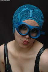 Blue head (monotematico) Tags: black blackbackground negro fondonegro female femaleportrait femalemodel femme femenino mujer persona retrato retratofemenino rubber rostro headgear hat hairless head cap contraste coveredhead capped composition contrast indoor interior individual individuo swimcap swimmingcap swimhat bathingcap badekappe badmuts bonnet portrait gorro gorrodenatacion gorra goma goggles gorrodebaño gorradenatación azul blue latex corsette