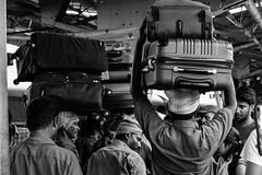 Bags | Visakhapatnam | India (gaalvarezc) Tags: street streetphotography stphotographia bw blackwhite blackandwhite black white people culture texture unexpected india train station bag canon 50mm visakhapatnam
