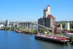 Temco Grain Elevator (PDX Bailey) Tags: grain elevator industrial portland oregon willamette river barge boat red blue skyline city urban
