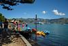 Needing Shade... Too Hot Today (Jocey K) Tags: bankspeninsula newzealand nikond750 akaroa hills sea akaroaharbour scene seascape trees clouds sky people boats ships cruiseships shadows water kayak