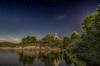 Noche en el Burguillo. (Amparo Hervella) Tags: embalsedelburguillo ávila españa spain paisaje cielo árbol roca estrella circumpolar noche nocturna reflejo agua ermitadelcarmen largaexposición d7000 nikon nikond7000