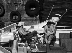 lazy hazy crazy days of summer (Anne Worner) Tags: anneworner bergen blackandwhite norway raymarine silverefex bw boat candid chairs deckchairs drinks inboard man mono monochrome ocean people resting street streetphotography sunning table tires outside outdoors sunny avaliablelight water rattan deckchair candidstreetphotography chains wall shadows bright warm sunscreen