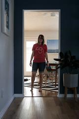 0525 Emily smiles through the doorway