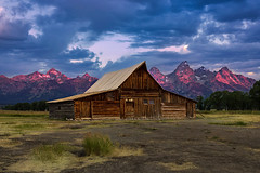 Grand Teton Vibrant Sunrise (NickSouvall) Tags: barn rural farm field grass blue sky dramatic clouds vibrant pink red light alpenglow glow sunrise sun color grand teton national park wyoming mountain peak range landscape nautre photography