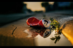 On the Coke Side of Life (marionrosengarten) Tags: red challenge rot coke drinkcan cokecan sun sunsetlight light reflection spiegelung reflektion bordstein gosse rinnstein curb gutter weed unkraut golden street strase nikon nikon50mmf18 evening storytelling stone water puddle puddlegram pfütze