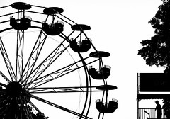 A Fairly Fun Silhouette (Ian Sane) Tags: ian sane images afairlyfunsilhouette city fair rose festival carnival ride monochrome black white candid street photography governor tom mccall waterfront park portland oregon silhouette canon eos 5ds r camera ef70200mm f28l is usm lens he