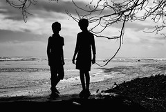 Boys Waiting for a Boat (Rod Waddington) Tags: africa african afrique afrika madagascar malagasy boys silhouette blackandwhite monochrome mono beach water ocean indian tree boat canoe outdoor culture cultural ethnic ethnicity