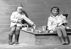 Tea for two (theirhistory) Tags: children kids girls hat coat boy trousers wellies boots