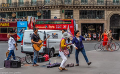 Dancing to the Buskers tune. (steve.gombocz) Tags: urbanstreet streetscene flickrstreet streetlife street streetphoto streetphotography streetphotograph flickraddicts purestreet out outandabout streetpictures streetphotos flickr exploreflickr streetmusic dance people streetentertainment streetbusker busker music guitar paris parisscene exploreparis flickrparis olympus olympususers olympusamateurs olympuszuikodigitalclub olympusem5mark2 olympusm1240mmf28 olympusomd bus bicycle cafeopera