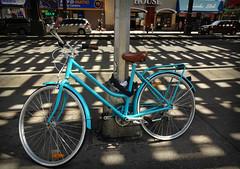 Blue Bike (Robert S. Photography) Tags: blue pole sidewalk spring stores street signs brooklyn newyork sony dscwx150 iso100 june 2018
