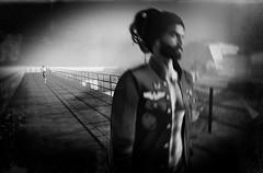 Sometimes Here and again (Gianmario Masala [inworld]) Tags: textures textured photoshop gimp blur blurry photograph gianmariomasala mono monochromatic bokeh woman female man male standing portrait hair eyes beard face sorrows shadows blckandwhite highandlowkey jacket night darkness metaverse bridge