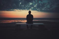 sitting, waiting, wishing (christian mu) Tags: sunset germany norderney meineinsel beach strand sand sea ocean northsea batis batis252 zeiss 252 25mm sony sonya7riii sonya7rm3 strandpromenade beachpromenade christianmu