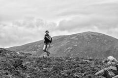 Hill walker (Frank Fullard) Tags: frankfullard fullard candid street portrait walker hill mountain sky backpack hiker hiking achill alt achillsound mayo irish ireland derreens monochrome blackandwhite blanc noir