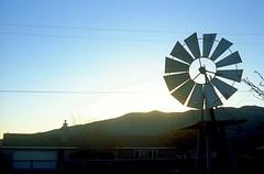 Sunrise at the Little Ranch (squirtiesdad) Tags: windmill sunrise littleranch mountains sun diyfilmscanning selfdeveloped epson v600 film photography project fpp c41 analogue analog petri 7s rangefinder kodak ektar iso100 color negative 35mm
