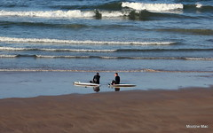 Surfers catching up (mootzie) Tags: surfers surfing beach sand sea aberdeen scotland relaxing chatting wetsuits waves surfboards blue