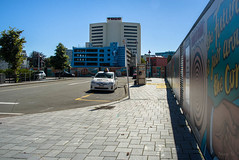 Waiting for a Fare (Jocey K) Tags: newzealand nikond750 christchurch building achitecture streetart artwork taxi fence cathedralsq mural cars sky trees
