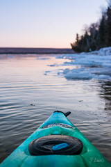 Kayak sits still at shore of icy winter lake (blurMEDIA Stock) Tags: brucepeninsula canada earth georgianbay ontario pfd active carpediem challenge climate climatechange determination environment environmental exercise fitness frozen fun globalwarming goodlife happy health healthy ice icy journey kayak kayaking lake lifejacket lifestyle living north northern outdoor perserverance planet refreshing rejuvenation relaxation retreat safety seasons skill solitary solitude sport warming winter wintersport