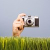 Stock Images (perfectionistreviews) Tags: color camera grass lens bodypart hand shutter studioshot picture photography film hobby memories stilllife square vintage caucasian man male photograph lifestylesandart