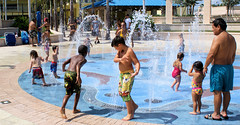 Pool Freeze (Andy Zito) Tags: pool freeze kids playing water fountains spraying frozen action caught time little enjoying sprinkles squirting parents bathing suits all wet hollywood beach park