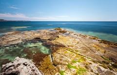 Low tide. (wild friday) Tags: sardinia lowtide longexposure landscape island sea mediterranean shore june sunnyday mistral