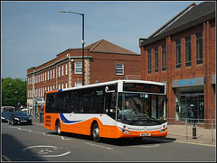 Tracel de Courcey 573, North Street (Jason 87030) Tags: northst street rugby town 585a warks warwickshire mercedes bus traveldecourcey mike service route may 2018 wheels orange white blue transportation roadside sony ilce alpha a6000 lens tag 573 ae12azf evolution mcv
