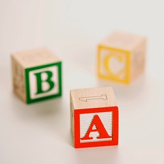 Stock Images (perfectionistreviews) Tags: stilllife studio nobody photograph color object indoors square education learning blocks block toys toy buildingblocks letters letter alphabet text englishtext whitebackground three selectivefocus communication educate elementaryschool language literacy school symbol concept conceptual a abc b c spelling learn