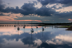 Rain On The Way (Sunset Snapper) Tags: rainontheway sunset langstoneharbour haylingisland hampshire southcoast uk calm rainclouds reflections yachts boats moody filters lee nd grad nikond810 2470mm seascape posts dusk may 2018 sunsetsnapper